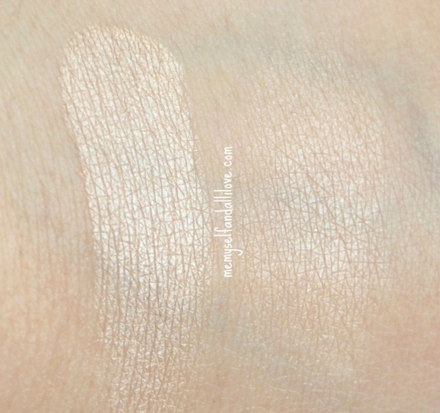 laura mercier baked highlighter swatch